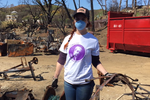 Photo of an alumni volunteer wearing a face mask while doing clean up work.