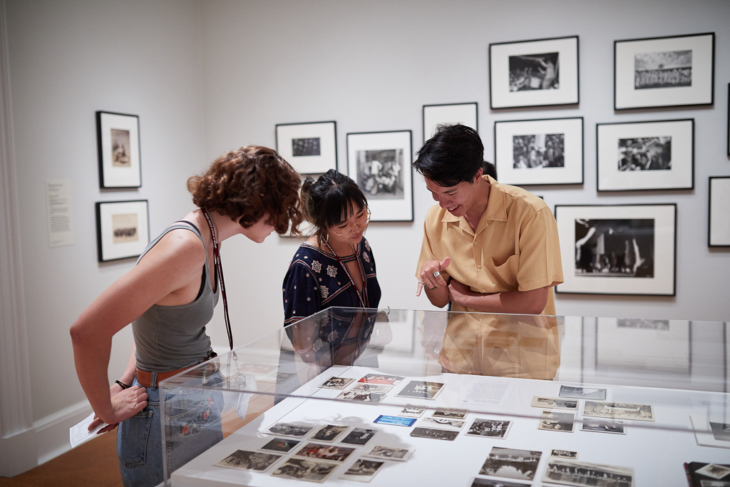 Photo of three students looking at an exhibit in the Museum