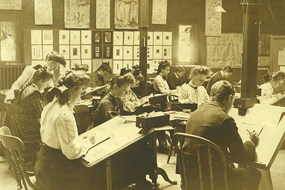 Historic 19th century photo of students in the studio.