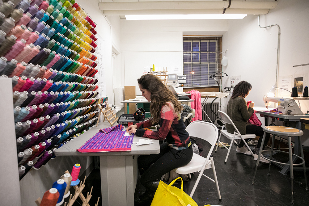 Photo of students in textile studio.