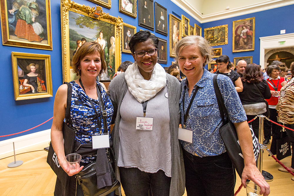 Three alumni posing in the RISD Museum Grand Gallery.