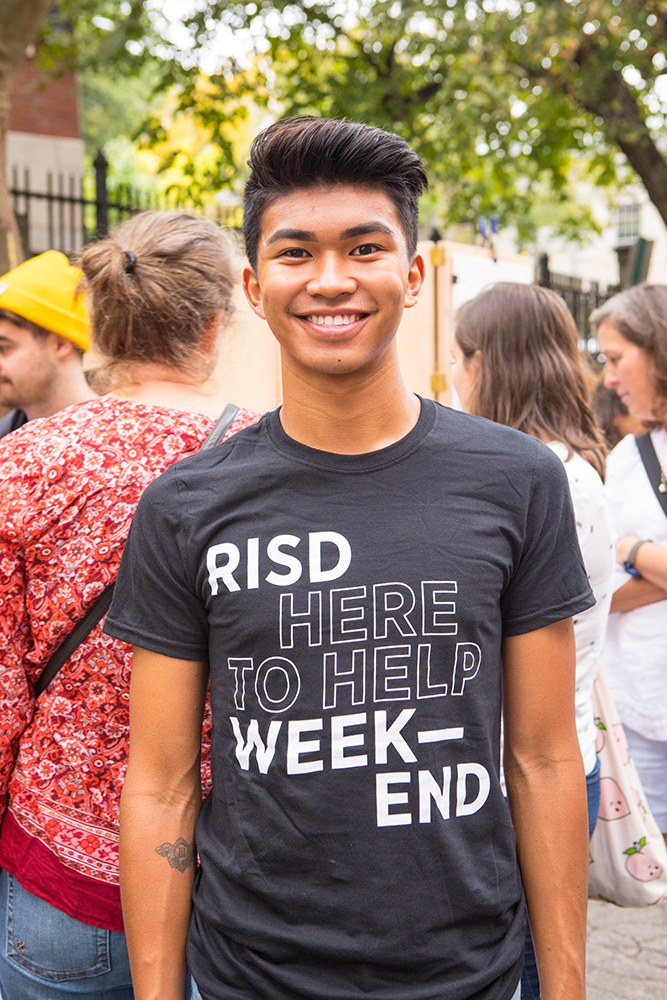 "Photo of a person wearing a ""RISD Weekend: Here to Help"" tshirt"
