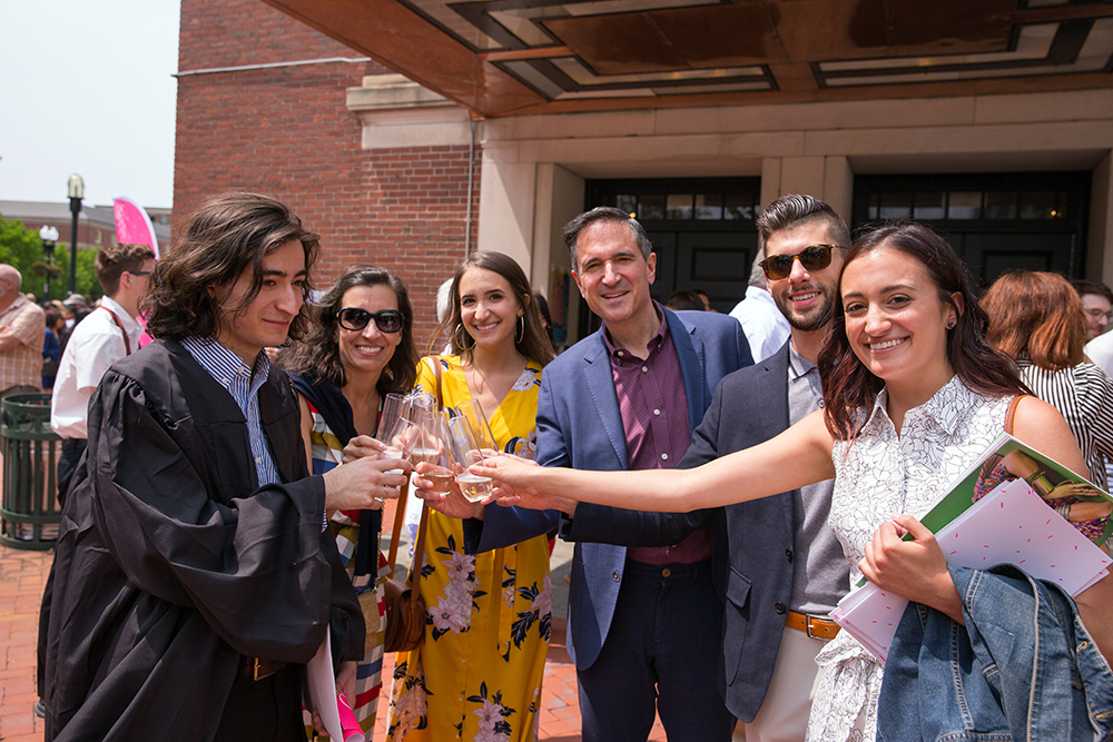 Alumni toast new graduates after the 2019 Commencement ceremony