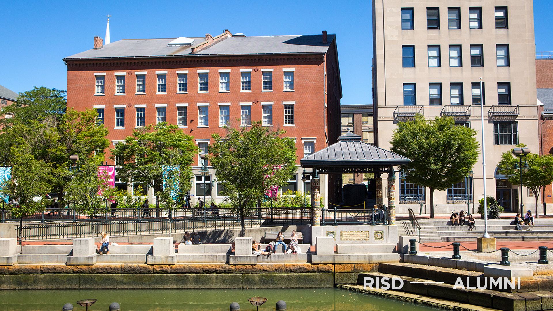 The Providence Canal Walk and the Illustration Studies Building on a sunny day.